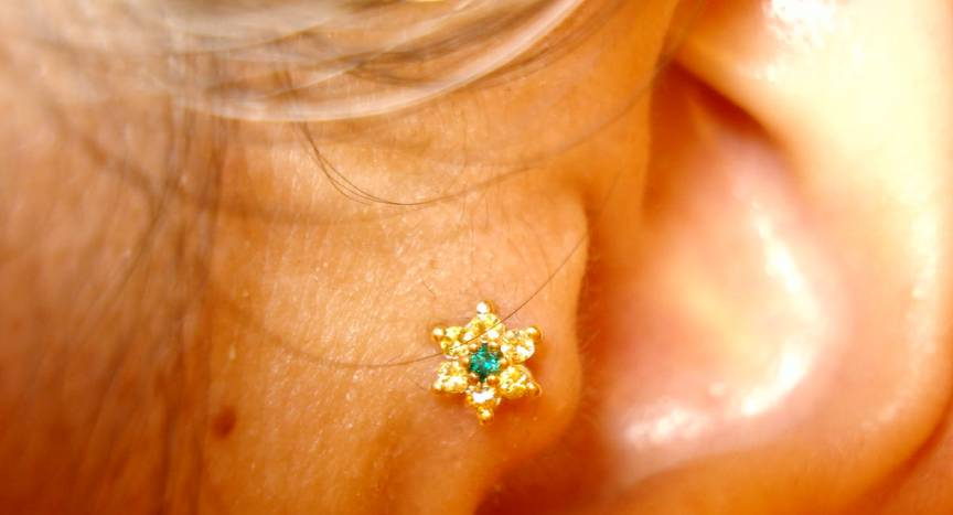Tragus piercing with star stud